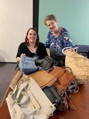 From left, Pamela Strobbe, event planner for La Casa and Linda Bartlett, Daughters of the American Revolution regent with a pile of donated purses for women fleeing domestic violence, Thursday Oct. 10, 2019.