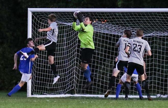 Salem goalie Quinn Tews makes a save against Plymouth.