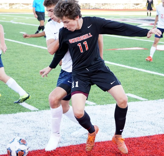 Franklin's Nicholas Corona battles with Churchill's Shawn Juliette for the ball.