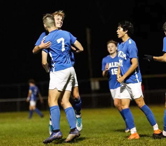 Salem's Ryan Doyle (7) celebrates with his teammates after scoring a goal against Plymouth.