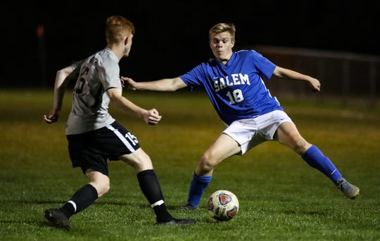 Salem's Joey Kobylas goes for the ball against Plymouth's Kyse Zeidieh.