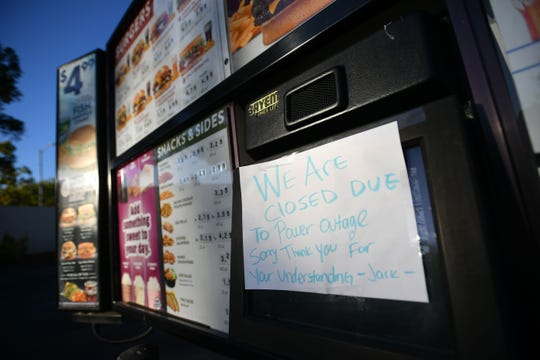 A Jack in the Box restaurant drive-thru has a sign posted indicating closure as a statewide blackout takes effect in Santa Rosa, California on October, 10, 2019. - Rolling blackouts set to affect millions of Californians began October 9, as Pacific Gas & Electric started switching off power to an unprecedented number of households in the face of hot, windy weather that raises the risk of wildfires. PG & E, which announced the deliberate outage, is working to prevent a repeat of a catastrophe last November in which faulty power lines it owned were determined to have sparked California's deadliest wildfire in modern history. (Photo by Josh Edelson / AFP) (Photo by JOSH EDELSON/AFP via Getty Images)
