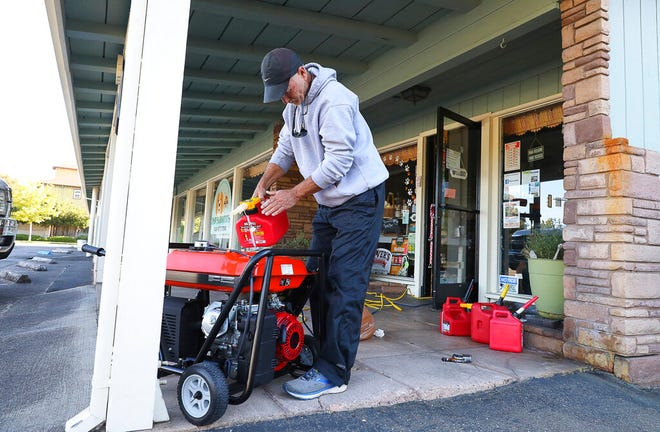 Pet shop owner Cliff Dunn runs a generator in order to keep a freezer full of raw pet food cold during a power outage in Santa Rosa, Calif., Wednesday, October 9, 2019.