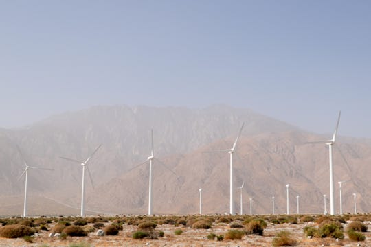 Dust blows through win turbines in North Palm Springs, Calif. on Thursday, October 10, 2019