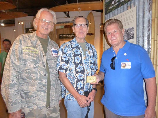 Vietnam vets Larry Martin, Al Daniels and China Beach Surf Club Dan Emerson pose for a photo.