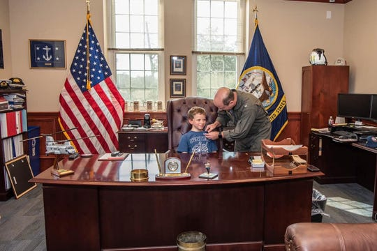 Kohlton James, a Milton 10-year-old with cancer, was named an honorary commanding officer Tuesday at NAS Pensacola
