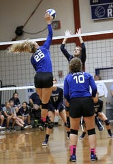 Junior Jada Lowry (25) goes up for a swing with support from setter Makenna Locklin (10) in an undated Jay volleyball match. The Royals have posted their best season in 30 years.