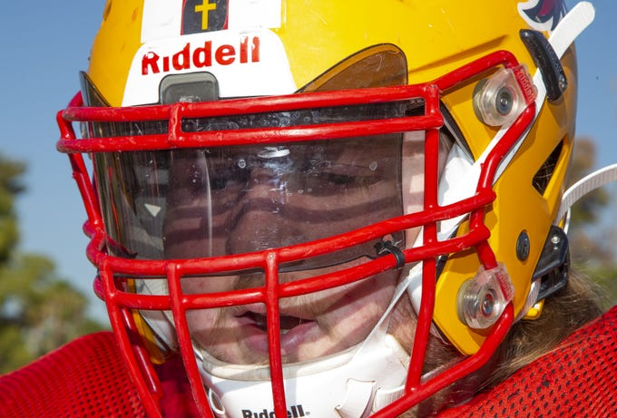 Arizona Christian's Josiah Winans, who is legally blind, wears a dark visor on his helmet to protect his eyes from bright lights.