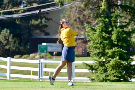 Port Huron Northern girls golfer Madison Bajis swings during the Division 2 regional on Thursday, Oct. 10, 2019, at Farmington Hills Golf Club.