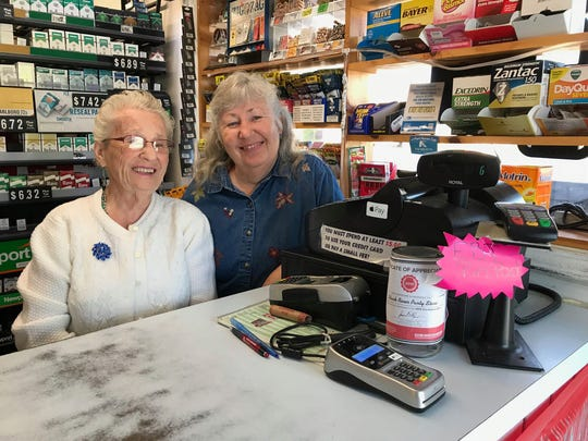 Margaret Enright and her daughter, Cindy Carlson, pose for a photo in the Black River Party Store. The women will be closing the store at 1236 Water St. in Port Huron on Sunday, Oct. 13.