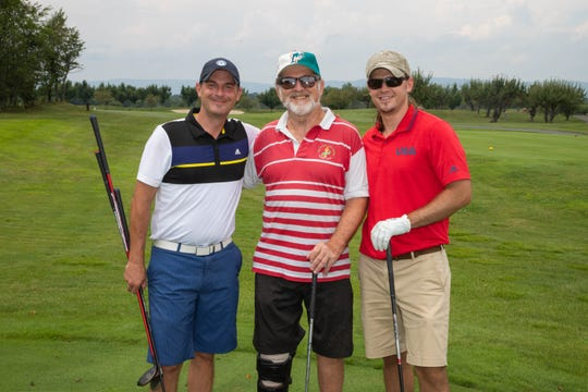 John Olsen, Richard Moscowitz, M.D., and Michael Moscowitz, M.D., pose on the green on their way to being crowned the winning team at the 19th annual HealthAlliance Golf Classic.