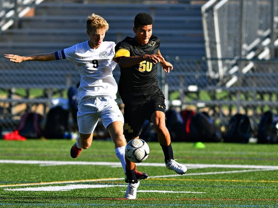 Dallastown's Kyle Reuter, left, and Red Lion's Logan Axe battle for control of the ball during boys' soccer action at Horn Field in Red Lion, Thursday, Oct. 10, 2019. Dallastown would win the game 3-2. The Wildcats are No. 1 in the District 3 Class 4-A power ratings. Dawn J. Sagert photo