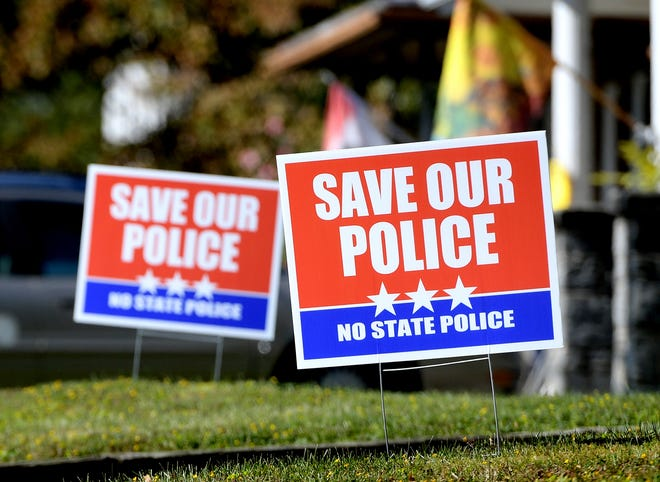 Signs along Market Street in Hallam Borough show support for continued service of the Hellam Township Police Department Wednesday, Oct. 10, 2019. Bill Kalina photod