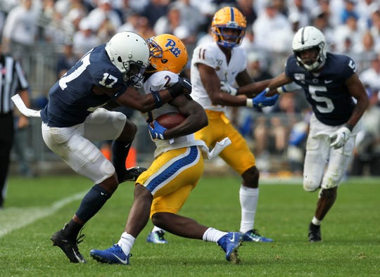 Sep 14, 2019; University Park, PA, USA; Penn State Nittany Lions safety Garrett Taylor (17) tackles Pittsburgh Panthers wide receiver Maurice Ffrench (2) during the fourth quarter at Beaver Stadium. Penn State defeated Pittsburgh 17-10. Mandatory Credit: Matthew O'Haren-USA TODAY Sports