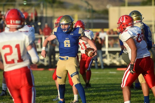 Reed's Jack Franz (6) celebrates a touchdown while taking on Wooster during their football game in Sparks on Aug. 23, 2019.
