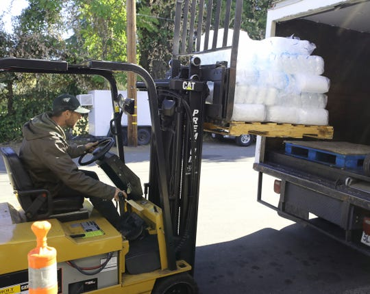 North State Ice employee Chris Jones loads another shipment of ice in Redding for a delivery during the PG&E outage on Thursday, Oct. 10, 2019. With the power out in Northern California, ice is in high demand.