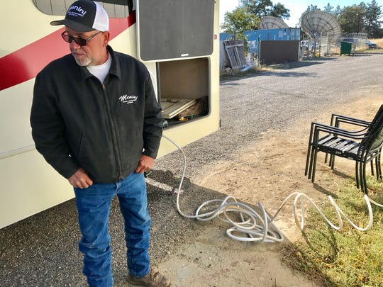 Jim Menini of Palo Cedro fills his rented RV with water behind the Palo Cedro Market on Thursday, Oct. 10, 2019. Menini's water well isn't working due to the PG&E outage. He's taking his wife to a Mayo Clinic in Scottsdale, Arizona, on Friday but will use the RV for showers Thursday before the trip.