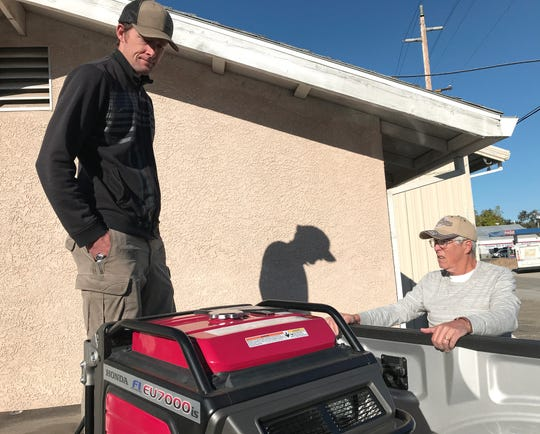 Palo Cedro Market owner Bryce Gebauer, left, and his father, John, check on one of the generators they were using to keep the market in business on Thursday, Oct. 10, 2019, during the PG&E outage.
