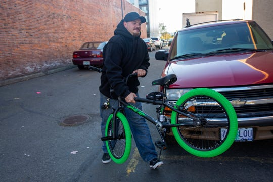 Josh Briggs surprises Dylan Isaacs with a new bike after his was stolen on Saturday, outside of Wild Things Games in Salem, Oct. 9, 2019. Briggs collaborated with almost a dozen to orchestrate the surprise gift.