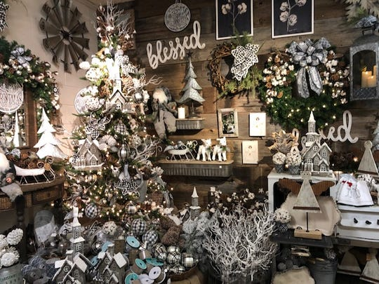 Olive's Nursery has a large selection of Christmas items on sale. For the month of October, artificial Christmas trees are half priced.