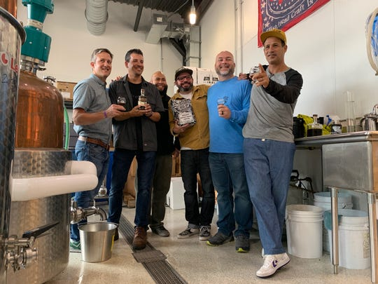 Rise Up founder Tim Cureton (center) and Dogfish Head founder Sam Calagione (right) will be releasing their collaborative spirit, Booze for Breakfast, at the brewery's annual Analog A Go Go on Nov. 9.