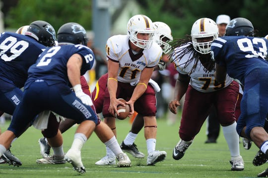 Salisbury University quarterback Joey Jones looks to pitch the ball to a running back during the first quater of action against Wesley College in 2013.