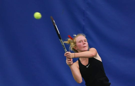 Tanna Lehfeldt of Brandon Valley hits a backhand during a game in the class AA state girls tennis tournament at the Huether Family Match Pointe tennis facility in Sioux Falls.