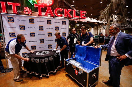 Springfield attorney Joe Passanise stands next to a case carrying the Stanley Cup as it is unpacked for fans to take photos with it at Bass Pro Shops on Thursday, Oct. 10. 2019.