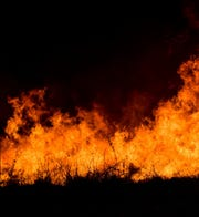 An Associated Press file photo shows flames.