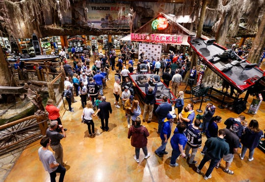 St. Louis Blues fans pose with the Stanley Cup at Bass Pro Shops in Springfield, Mo. on Thursday, Oct. 10, 2019.
