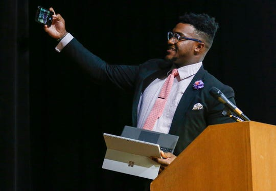 Daniel Ogunyemi, of CASA, takes a selfie before speaking during the Community Focus Report presentation at the Springfield Art Museum on Thursday, Oct. 10, 2019.