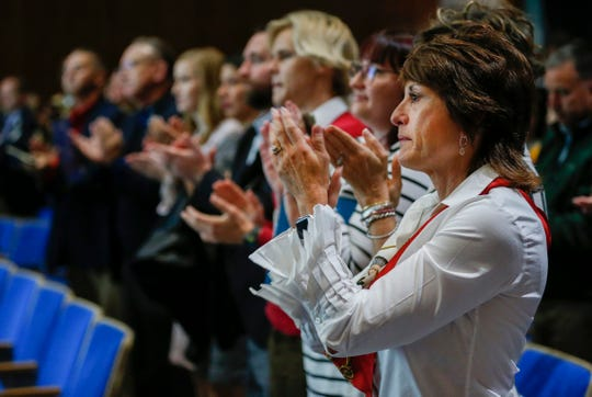 Susie Turner, right, along with the rest of the audience gives Kara Hodges a standing ovation after she talked about her experiences in an abusive relationship during the Community Focus Report presentation at the Springfield Art Museum on Thursday, Oct. 10, 2019.