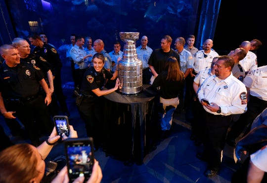 Springfield Police Lt. Jennifer Charleston poses with the Stanley Cup during a viewing for first responders at Wonders of Wildlife on Thursday, Oct. 10, 2019.