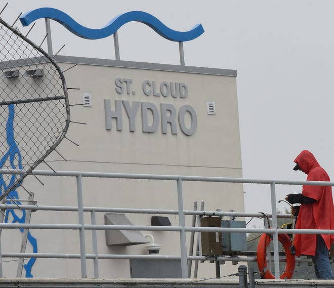 A worker at St. Cloud Hydro on a rainy day Thursday, Oct. 10, 2019.