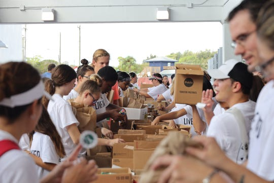 Indian River County middle and high school students assemble over 3,000 weekend snack packs to be distributed to local elementary school students during the 2019 Day of Caring on Oct. 5.