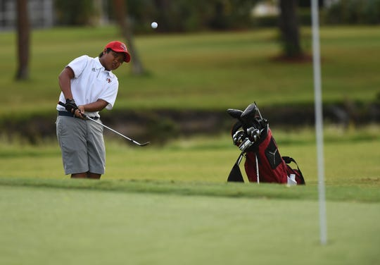 Nashawn Tyson, of South Fork High School, chips onto the third green during the Treasure Lake Conference Boys Golf Championship at the Saints Golf Course on Thursday, Oct. 10, 2019, in Port St. Lucie.  CQ:Nashawn Tyson
