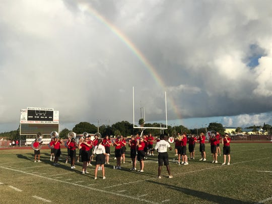 Vero Beach High School Fighting Indians Marching Band members perform under a rainbow at Billy Livings Field at the start of United Way of Indian River County's Day of Caring on Oct. 5, 2019.