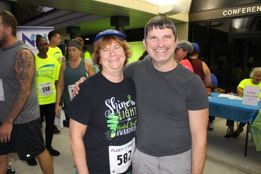 Ann Posey, left, with New Horizons CEO George Shopland at the Race for Recovery 5K Run/Walk at Indian River State College Pruitt Campus.