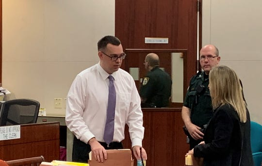 Murder suspect Michael Jones speaks with Amy Perron, a private investigator and member of his court-appointed legal team with the Public Defender's Office, during jury selection on Oct. 10, 2019 at the Indian River County Courthouse.