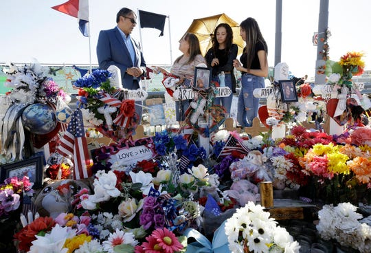 El Paso city Rep. Henry Rivera, of District 7, talks with Yolanda Tinajero, sister of Walmart shooting victim Arturo Benavides, and Benavides' great-nieces Katelyn Armendariz, 14, center, and Meghan Armendariz, 16, as they discuss plans for the memorial. Tinajero said she didn't want to attend the arraignment Thursday, Oct. 10, 2019.