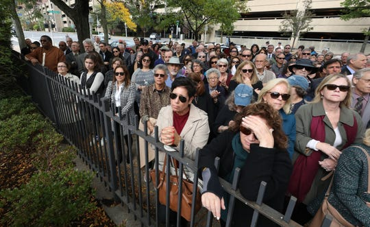 Hundreds of people fill the sidewalk in front of the Holocaust Garden of Remembrance in White Plains, during an interfaith vigil Oct. 10, 2019.