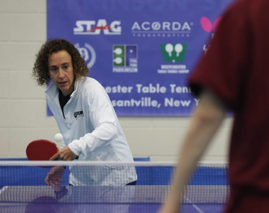 Pleasantville's Margie Alley plays Alan Abt, of Bedford during a practice session at Westchester Table Tennis Center in Pleasantville Oct. 9, 2019. The first International Table Tennis Foundation World Parkinson's Table Tennis Championship takes place Oct. 11-13, 2019.