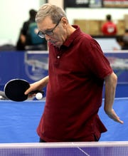 Alan Abt, of Bedford who has Parkinson's plays pingpong during a practice session at Westchester Table Tennis Center in Pleasantville Oct. 9, 2019.