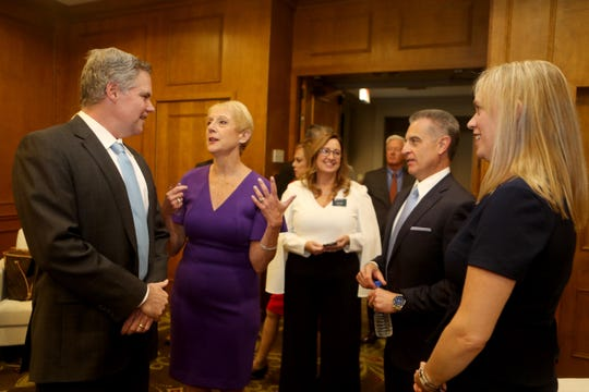 Jim Murren, Chairman and CEO of MGM Resorts International, left, speaks with Marcia Gordon, President and CEO of the Business Council of Westchester, Taryn Duffy, V.P. of Corporate Communications and Public Affairs for Empire City Casino, Tony Justic, outgoing chairman of the board or directors of the business council, and Heidi Davidson, incoming chair of the board of directors, during the business council's annual dinner at the Hilton in Rye Brook Oct. 10, 2019. Murren delivered the keynote address at the dinner.