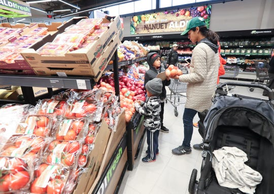 Shoppers make their way around the store during the grand opening of Aldi Supermarket's Nanuet location on Thursday, October 10, 2019.