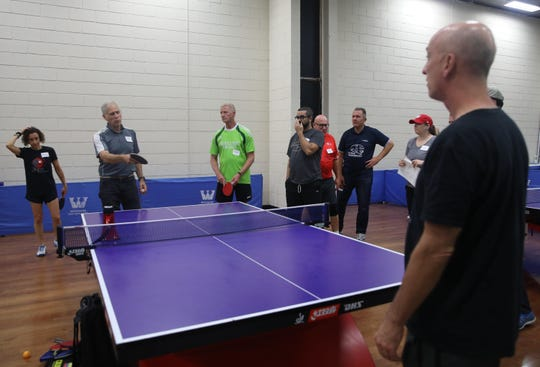 Art Dubow, of Stamford, Connecticut, a retired psychologist who helped found Ping Pong Parkinson gives tips on serving during a practice session at Westchester Table Tennis Center in Pleasantville Oct. 9, 2019. The first International Table Tennis Foundation World Parkinson's Table Tennis Championship takes place Oct. 11-13, 2019.