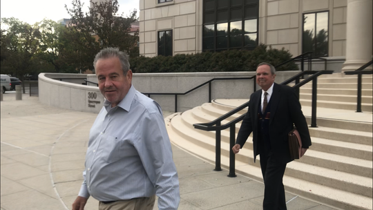 Gregory Bayard, left, leaves federal court in White Plains with his lawyer Clinton Calhoun after he was sentenced to two years in prison for stealing more than $1.4 million from a Mount Vernon man's estate.