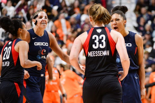 Kristi Toliver #20, Elena Delle Donne #11, and Aerial Powers #23 react with teammate Emma Meeseman #33 of the Washington Mystics in the fourth quarter of Game 3 of the WNBA Finals against the Connecticut Sun at Mohegan Sun Arena on Oct. 6, 2019 in Uncasville, Connecticut.
