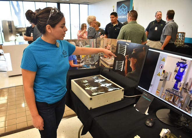 Denise Figueroa, an X-ray reader, talks about the methods of inspecting the jet engine parts manufactured at Arconic in this Oct. 10, 2019, file photo. The company was celebrating 40 years in Wichita Falls and originally opened under the name Howmet. It is now Howmet Aerospace Engine Systems after Howmet and Arconic split on April 1.
