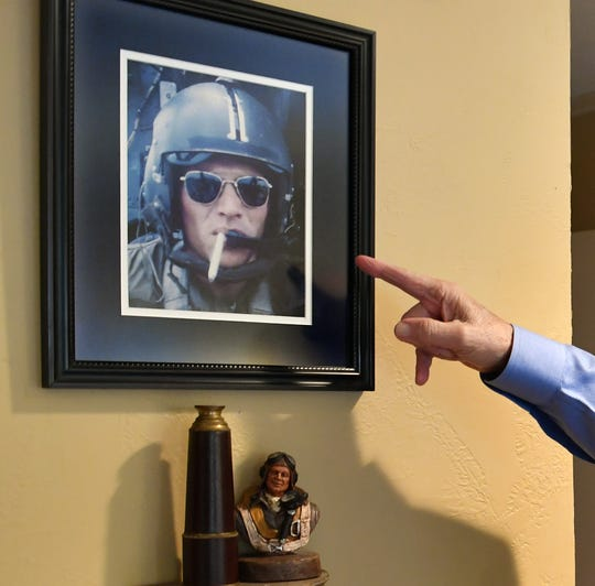 A self-portrait photograph that Kenn Hill shot during one of his two tours as a combat helicopter pilot in Vietnam. Hill will participate in an Honor Flight next month to Washington D.C.